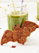 A cinnamon bat biscuit and a green smoothie for Halloween