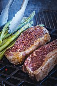 Beef steak and green asparagus on the barbecue