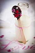 A chocolate spoon and a milk bottle for Valentine's Day