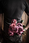 Man holding bouquet of roses for Valentine's Day