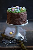 An Easter cake decorated with a chocolate glaze and sugar eggs