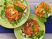 Sweet potato fritters with dandelion leaves and nuts