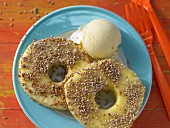 Pineapple with a sesame seed coating served with ice cream