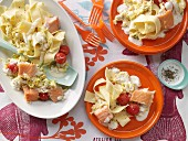 Salmon with tagliatelle and vegetables in a creamy sauce