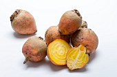 Golden beets on a white surface