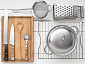 Kitchen utensils for preparing tomato curry with mozzarella