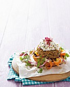 Quinoa burger with vegetables and a quark dip