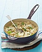 Risotto with fresh basil in a pan