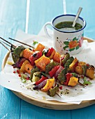 Grilled vegetable kebabs with herb oil