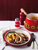 Turkey sausages with pumpkin puree and onion sauce