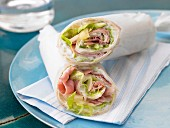 A wrap with ham, cream cheese, pineapple and lettuce