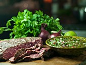 A flank steak with chimichurri (Argentina)