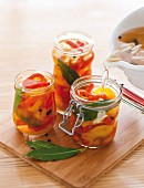 Pickled red and yellow pepper in preserving jars