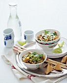 Chinese egg noodles with chicken and coriander leaves