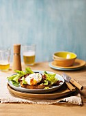 Ciabatta with bacon, poached egg and salad