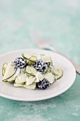 Detox cucumber salad with blackberries and soya yoghurt sauce