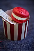A red macaron with a gift tag and romatic message for Valentine's Day