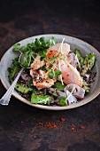 Salad with salmon, quinoa, cucumber, radish and cress