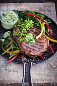 Steak with herb butter and colourful chard