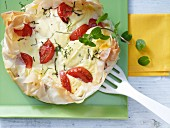 A cream cheese tart with tomato and mint