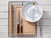 Assorted kitchen utensils for preparing tarts