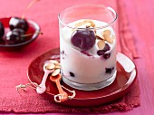 Orange yoghurt with cherries and almonds