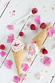 Frozen yoghurt with raspberries and meringue flowers