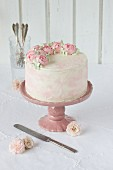 A wedding cake with buttercream roses