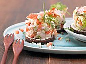 Trout tartare on Pumpernickel bread rounds