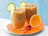An exotic cucumber drink with papaya and orange