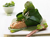 Salmon in a banana leaf with coconut chilli paste