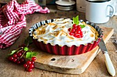 A pie with redcurrant filling topped with toasted meringue
