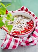 Baked porridge oats with redcurrants