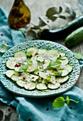 Courgette carpaccio with chilli flakes and herbs
