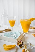 Mango & passion fruit cocktail with physalis
