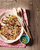 Fillet of pork glazed with ginger on a bed of egg noodles
