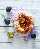 A Danish pastry with plums (seen from above)