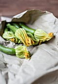 Courgette flowers in a paper bag