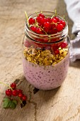 A breakfast jar with yoghurt, cheia seeds and redcurrants