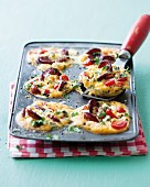 Chorizo, tomato and feta tarts in a cake tin