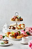 Sweet and savoury snacks on a tiered cake stand for afternoon tea