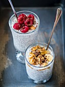 Overnight chia seed and coconut milk pudding served with fruits, nuts and dark chocolate