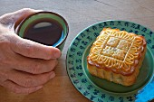 A Chinese mooncake and cup of tea