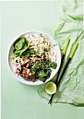 Grilled beef with sesame seeds and rice noodle salad