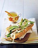 A Caesar sandwich with chicken, avocado and cos lettuce