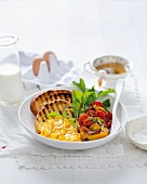 A superfood brunch: pepper filled with cocktail tomatoes and served with scrambled egg and toasted bread