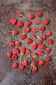 Fresh raspberries on a metal surface (seen from above)