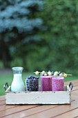 Blueberry smoothies on a garden table