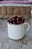 Cherries in an enamel cup