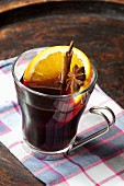 Mulled wine with cinnamon, star anise and orange slices
